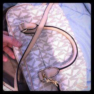 MK purse. Can be a sling or regular purse